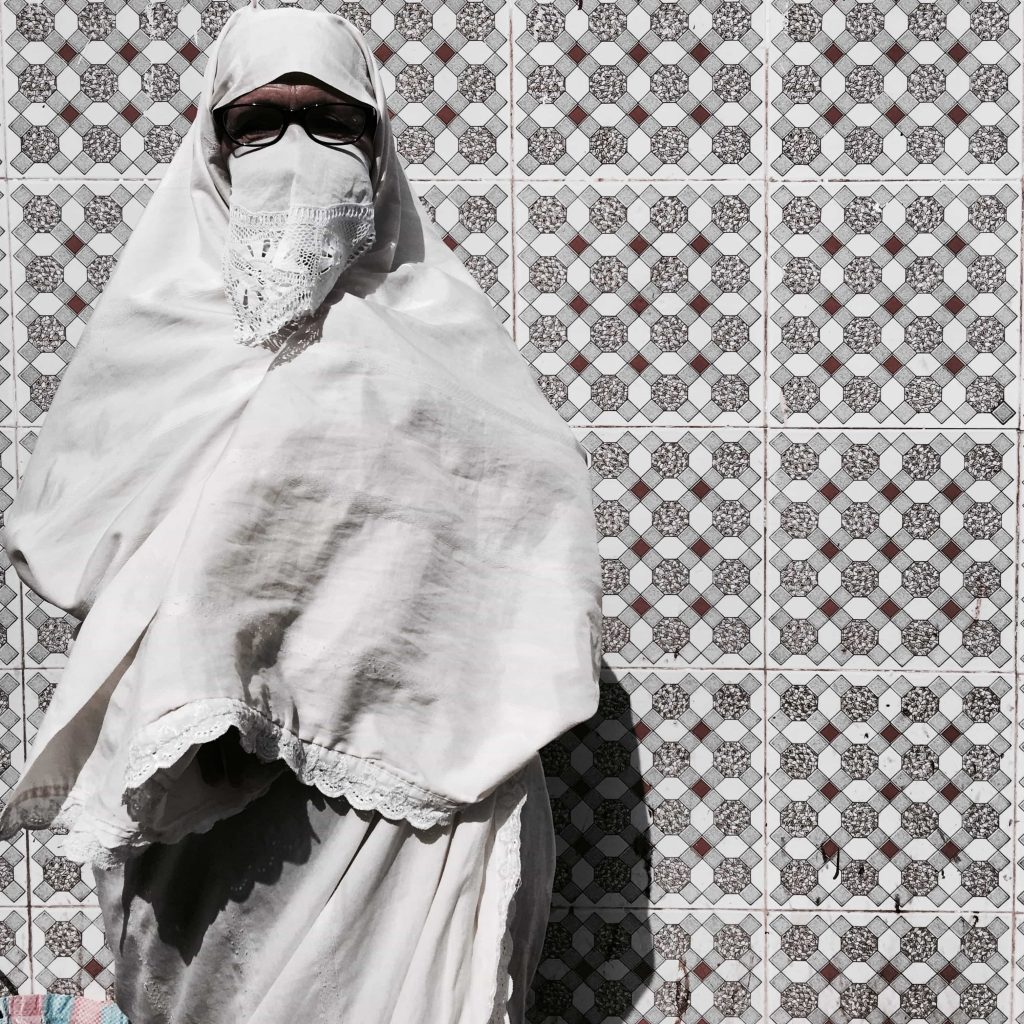 Algerian woman wearing the traditional white Hijab called Hayek Taken in Algiers July 2016