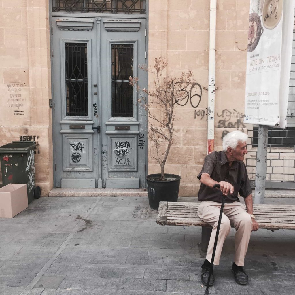Old Cypriot man sitting on a bench in Nicosia Photo taken in October 2015JPG