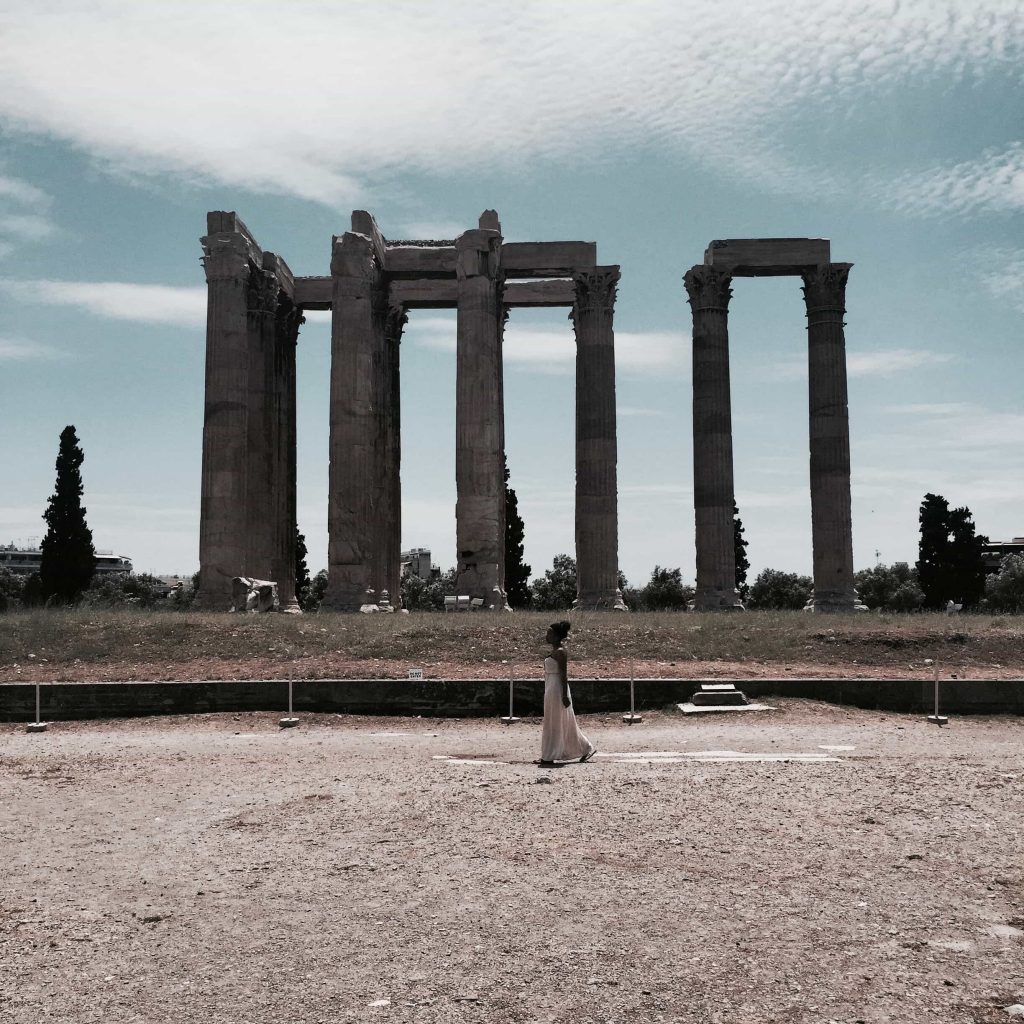 Woman walking by the Temple of Zeus Taken in Athens in May 2015