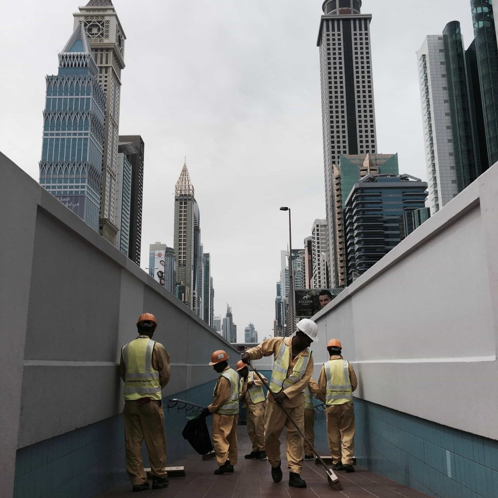 Dubai team of cleaners working in Dubai Sheikh Zayed road Taken in April 2016