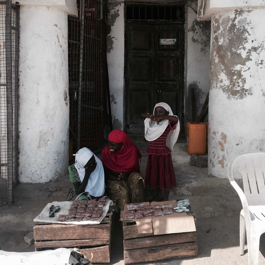 Peanut girls smiling in the streets of Lamu Taken in December 2016