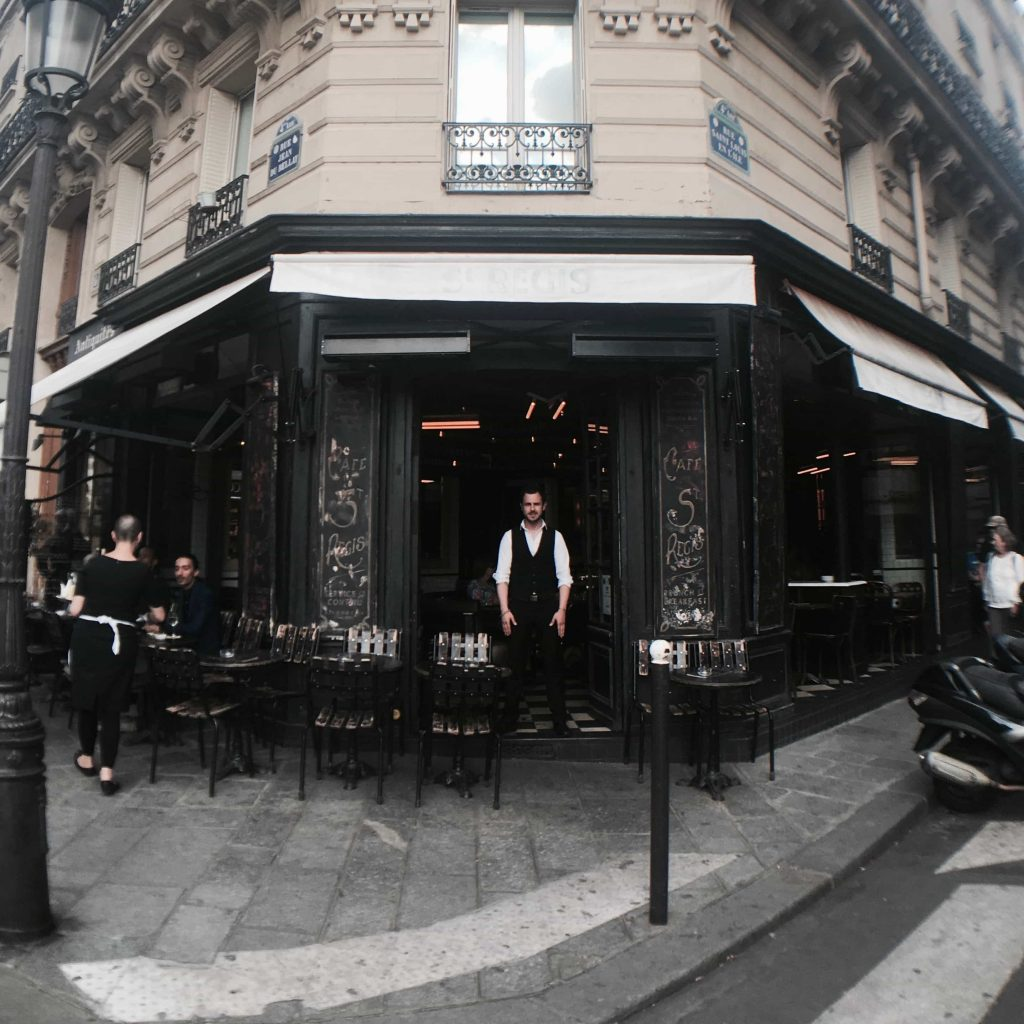 Parisian waiter standing in front of his restaurant in Notre dame district Photo taken in July 2016